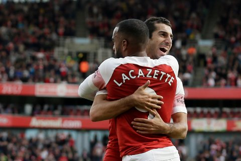 Arsenal's Alexandre Lacazette celebrates with Arsenal's Lucas Torreira his side's second goal with his teammates after his shot deflected by West Ham's Issa Diop scoring own goal during the English Premier League soccer match between Arsenal and West Ham United at the Emirates Stadium in London, Saturday Aug. 25, 2018. (AP Photo/Tim Ireland)