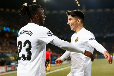Valencia's Michy Batshuayi, left, celebrates scoring with teammate Carlos Soler during the Champions League group stage group H soccer match between Switzerland's BSC Young Boys Bern and Spain's Valencia CF, at the Stade de Suisse Stadium in Bern, Switzerland, Tuesday, Oct. 23, 2018. (Peter Klaunzer/Keystone via AP)