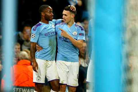 Manchester City's Phil Foden, right, celebrates with Manchester City's Raheem Sterling after scoring his side's second goal during the group C Champions League soccer match between Manchester City and Dinamo Zagreb at the City of Manchester Stadium in Manchester, England, Tuesday, Oct. 1, 2019. (AP Photo/Dave Thompson)