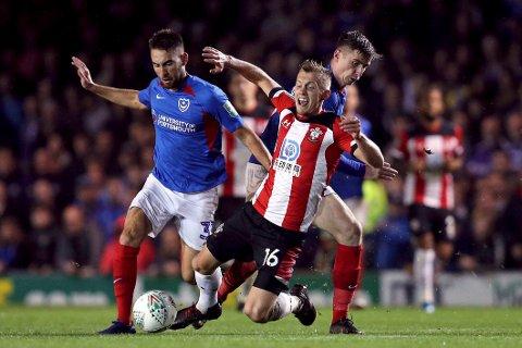 Portsmouth og Ben Clos (t.v.) røk ut av FA-cupen mot Premier League-laget Southampton i fjerde runden sist sesong.  (Andrew Matthews/PA via AP)