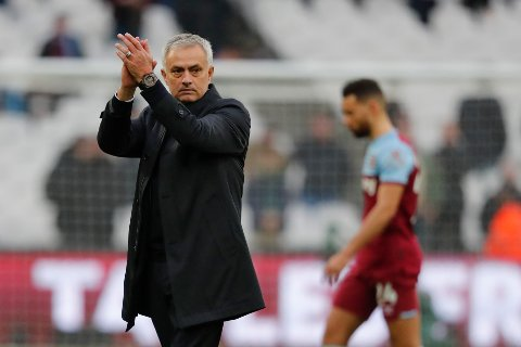 Tottenham's manager Jose Mourinho applauds at fans at the end of the English Premier League soccer match between West Ham and Tottenham, at London stadium, in London, Saturday, Nov. 23, 2019.(AP Photo/Frank Augstein)