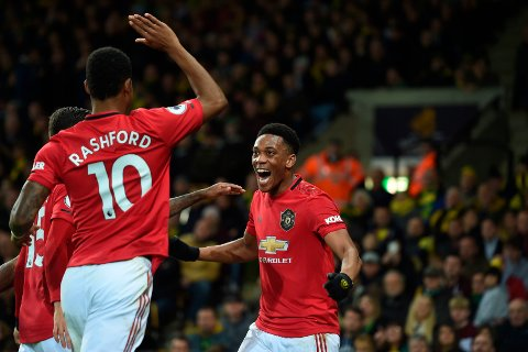 Manchester United's Anthony Martial celebrates scoring his side's third goal during the Premier League match between Norwich City and Manchester United, at Carrow Road, Norwich, Britain, Sunday, Oct. 27, 2019.  (Joe Giddens/PA via AP)