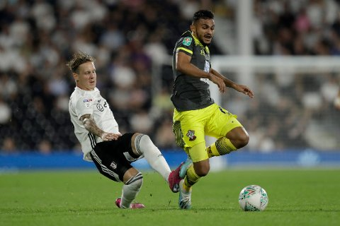 Fulham's Stefan Johansen, left, competes for the ball with Southampton's Sofiane Boufal during the English League Cup second round soccer match between Fulham and Southampton at Craven Cottage stadium in London, Tuesday, Aug. 27, 2019. (AP Photo/Matt Dunham)