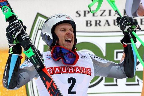 Norway's Henrik Kristoffersen celebrates at the finish area of an alpine ski, men's World Cup giant slalom, in Alta Badia, Italy, Sunday, Dec. 22, 2019. (AP Photo/Alessandro Trovati)