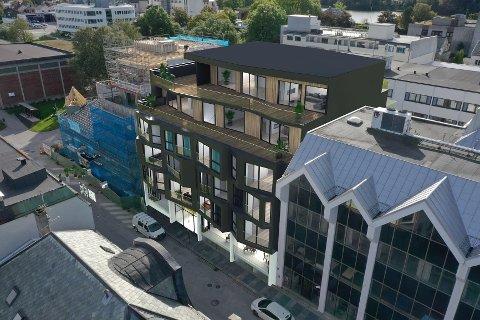 IMELLOM: Strandgata 56 er ein bygård mellom prosjektet som vi i denne illustrasjonen ser er under bygging til venstre i bildet (Strandgata 58), og Sparebankbygget.