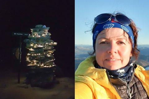 FØRJULSMORO: Mona Birkeland pynta varden på toppen Rossvikheia i Hyllestad første søndag i advent.
