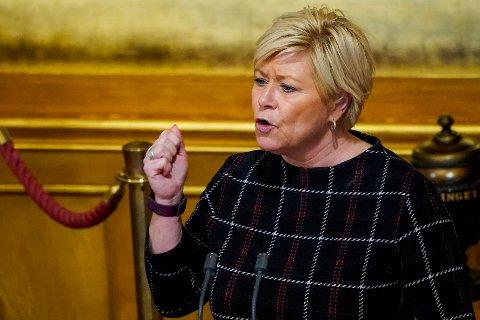 Siv Jensen (Frp) under debatten i Stortinget etter at statsminister Erna Solberg (H) hadde redegjort om håndteringen av koronapandemien. Foto: Håkon Mosvold Larsen / NTB