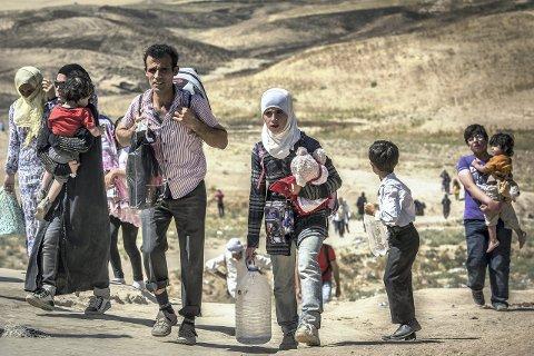 På flukt: Stortinget har vedtatt å ta inn 8000 ekstra flyktninger fra Syria over de tre neste årene. Flere Helgelandskommuner har sagt ja til å bidra. Foto: Christian Jepsen, Flyktninghjelpen
