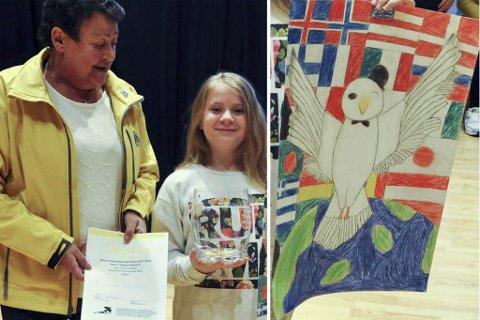 Vinneren : Erna Martinsen i Lions Club Nordkapp delte ut diplom og Lions-vase til vinner av tegnekonkuransen Regina Hrafnsdottir som går i 6. trinn ved Honningsvåg skole.