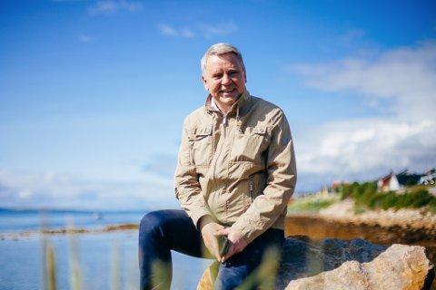 GRØNN SATSING: Terje Skansen, toppsjef i Varanger Kraft, er så optimistisk med tanke på gigantplanene i Berlevåg, at han tør ta på seg det store smilet.