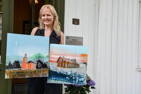 KONGSBERGBILDER: Kjersti Rahbek Hvamb stiller ut på Gamle Glitre gård på Lågdalsmuseet i sommer. Hun har malt seg gjennom Kongsbergs gater. Husene skal ligne, men omgivelsene har kunstneren brukt fri fantasi på å forme.