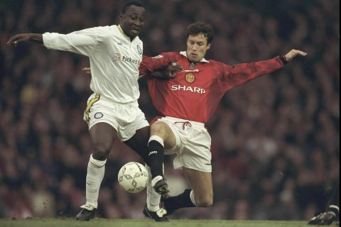 28 Dec 1996:  Tony Yeboah of Leeds (left) is challenged by Ronny Johnson of Manchester United during the Premier League match at Old Trafford, Manchester. Manchester United won 1-0. Mandatory Credit: Clive Brunskill/Allsport