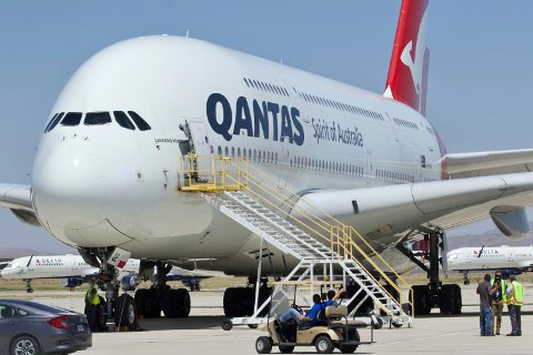 FILE - In this July 6, 2020, file photo, a Qantas Airbus A380 arrives at Southern California Logistics Airport in Victorville, Calif. Qantas Chief Executive Alan Joyce, Australia's largest airline, said that once a virus vaccine becomes widely available, his carrier will likely require passengers use it before they can travel abroad or land in Australia. (AP Photo/Matt Hartman, File)