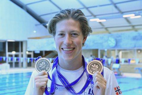 TO MEDALJER: Henrik Christiansen fikk med seg ett sølv og en bronse fra kortbane-VM i Kina. Svømmeren kom til Lambertseter fra Skjetten i sommer.