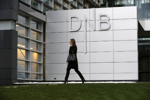 A woman walks past DNB bank's local office in Riga November 20, 2013.   REUTERS/Ints Kalnins/File Photo               GLOBAL BUSINESS WEEK AHEAD PACKAGE - SEARCH 'BUSINESS WEEK AHEAD 24 OCT'  FOR ALL IMAGES