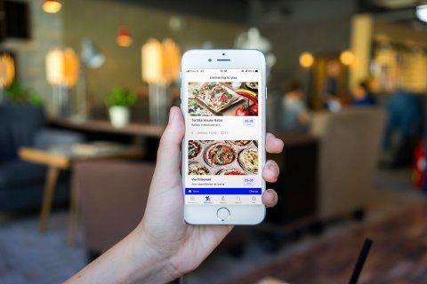 LEVERINGSKRIG: Appene Wolt og Foodora kjemper om kundene i Tromsø. Denne uka tok tyske Foodora opp kampen med den finske leveringstjenesten i Tromsø.