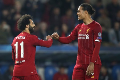 Liverpool's Mohamed Salah, left, is congratulated by Liverpool's Virgil van Dijk after scoring his sides fourth goal during a Champions League group E soccer match between Genk and Liverpool at the KRC Genk Arena in Genk, Belgium, Wednesday, Oct. 23, 2019. (AP Photo/Francisco Seco)