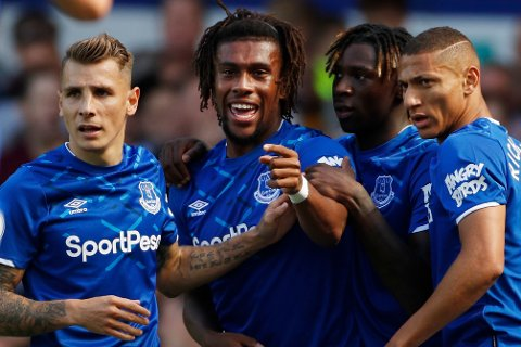 Everton's Alex Iwobi, 2nd left, celebrates after scoring his side's second goal during the English Premier League soccer match between Everton and Wolverhampton Wanderers at Goodison Park in Liverpool, England, Sunday, Sept 1, 2019. (AP Photo/Rui Vieira)