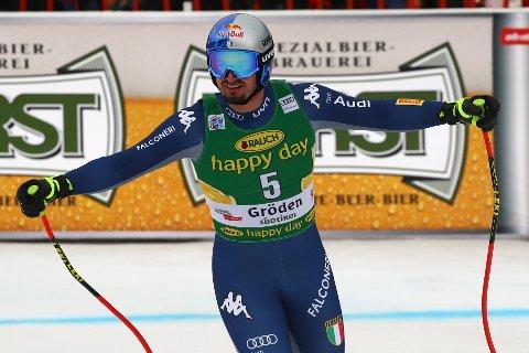 Italy's Dominik Paris celebrates at the finish area of an alpine ski, men's World Cup Super G, in Val Gardena, Italy, Friday, Dec. 20, 2019. (AP Photo/Alessandro Trovati)