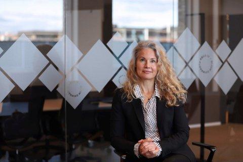 STRÅLENDE FORNØYD: Kommunikasjonsdirektør Anette Bjerke i Lånekassen forteller at den flytende renten er rekordlav.