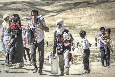 På flukt: Flere kommuner bidrar til å ta mot flyktninger. Foto: Christian Jepsen, Flyktninghjelpen