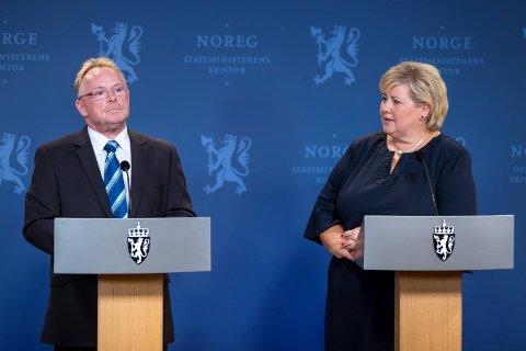 Fra pressekonferanse med statsminister Erna Solberg og avtroppende fiskeriminister Per Sandberg. Foto: Heiko Junge / NTB scanpix
