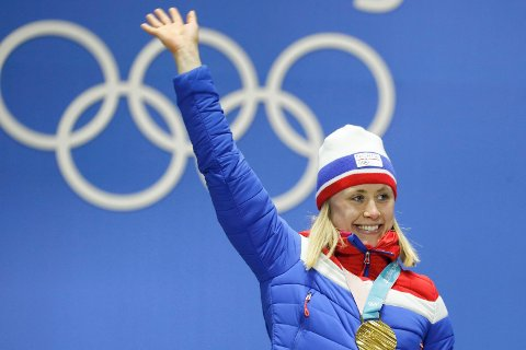OL-gull: Ragnhild Haga mottar gullmedalje for seieren i 10 km fristil. Grunnlag for gullet la hun på Sjusjøen i jula hvor hun også vant romjulsrennet. Akkurat det kan virke som en suksessoppskrift for å vinne OL-gull. Foto: Cornelius Poppe / NTB scanpix