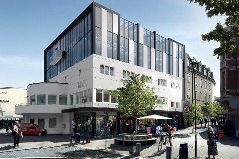 FÅR TO NYE ETASJER: Slik vil gårdeier Nils Tronrud bygge på Rutebilgården i Hønefoss sentrum. Illustrasjon: Halvorsen & Reine