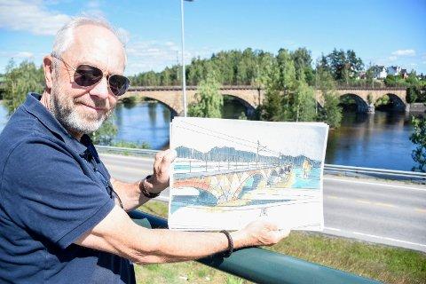 LYSSETTING: Jan Helge Østlund viser fram Erik Karlsens skisse, som antyder hvordan jernbanebrua kan bli til et monument ved hjelp av belysning.