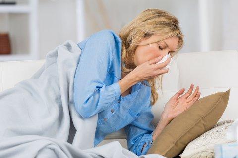 sick woman sneeze