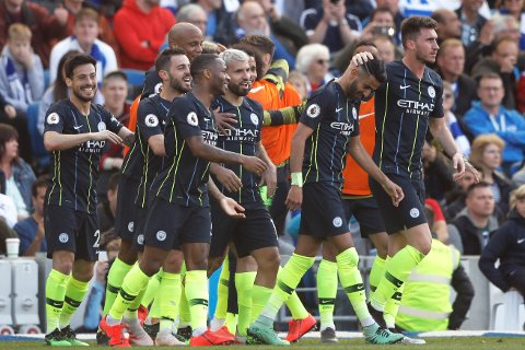 Manchester City's Riyad Mahrez, 2nd right, celebrates after scoring his side's third goal during the English Premier League soccer match between Brighton and Manchester City at the AMEX Stadium in Brighton, England, Sunday, May 12, 2019. (AP Photo/Frank Augstein)