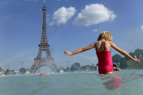 A girl cools off in the fountain of the Trocadero, in Paris, Tuesday, June 25, 2019. Authorities warned that temperatures could top 40 degrees Celsius (104 Fahrenheit) in some parts of Europe over the coming days, the effect of hot air moving northward from Africa. French Health Minister Agnes Buzyn said more than half of France is on alert for high temperatures Tuesday and the hot weather is expected to last until the end of the week. (AP Photo/Alessandra Tarantino)