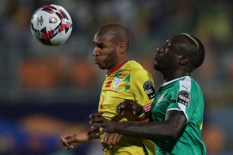 Benin's Jordan Adeoti, left, fights for the ball with Senegal's Mbaye Diagne during the African Cup of Nations quarterfinal soccer match between Senegal and Benin in 30 June stadium in Cairo, Egypt, Wednesday, July 10, 2019. (AP Photo/Hassan Ammar)