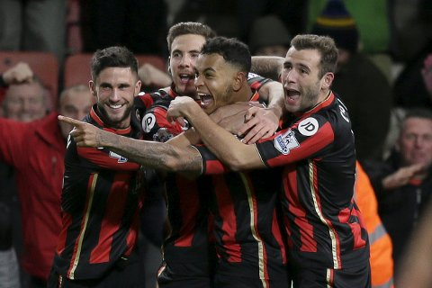 Bournemouth?s Joshua King, centre, celebrates after scoring a goal during the English Premier League soccer match between Bournemouth and Manchester United at the Vitality Stadium in Bournemouth, England, Saturday Dec. 12, 2015. (AP Photo/Tim Ireland)