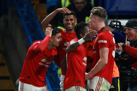 Manchester United's Marcus Rashford, background center, celebrates after scoring his side's second goal during the English League Cup soccer match between Chelsea and Manchester United at Stamford Bridge in London, Wednesday, Oct. 30, 2019. (AP Photo/Ian Walton)