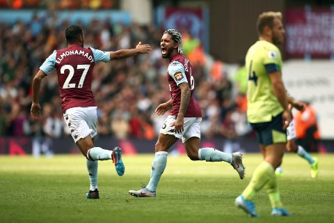 Aston Villa's Douglas Luiz, centre, celebrates scoring his side's first goal of the game with Ahmed Elmohamady, during the English Premier League soccer match between Aston Villa and Bournemouth, at Villa Park, in Birmingham, England, Saturday, Aug. 17, 2019. (Tim Goode/PA via AP)