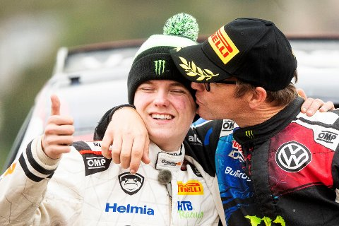 Petter Solberg (NOR) celebrates first place in WRC 2 category on the podium with Oliver Solberg (NOR) in first place after winning the World Rally Championship Great Britain in Llandundo,Great Britain on October 6 2019 // Jaanus Ree/Red Bull Content Pool // AP-21SU8H1C51W11 // Usage for editorial use only //