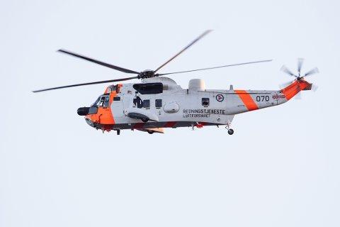 Søk med helikopter etter savnet person.