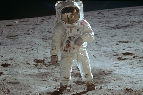 In this July 20, 1969 photo made available by NASA, astronaut Buzz Aldrin, lunar module pilot, walks on the surface of the moon during the Apollo 11 extravehicular activity.