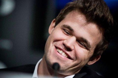 Magnus Carlsen, opprinnelig fra Tønsberg, kan smile etter et tilbakelagt maraton-VM.