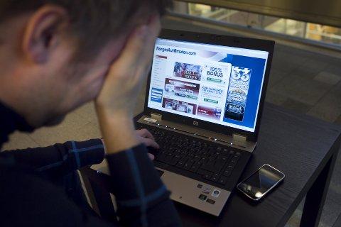 (Bilde 1) RUIN: Mange nordmenn pådrar seg enorm spillegjeld. Spillavhengighet Norge er bekymret Foto: Heiko Junge / Scanpix  FOTO: Junge, Heiko / Scanpix