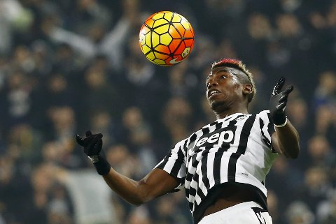 Football Soccer - Juventus v Napoli - Italian Serie A - Juventus Stadium, Turin, Italy - 13/02/16   Juventus' Paul Pogba jumps for the ball. REUTERS/Stefano Rellandini TPX IMAGES OF THE DAY
