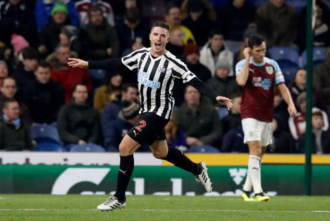 Newcastle United's Ciaran Clark, left, celebrates scoring against Burnley during the English Premier League soccer match at Turf Moor, Burnley, England, Monday Nov. 26, 2018. (Martin Rickett/PA via AP)