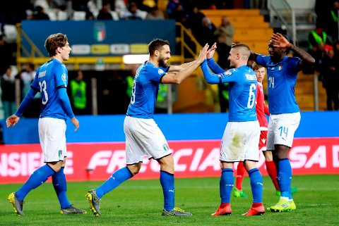 Italy's Leonardo Pavoletti, second from left, with his teammates Nicolo Zaniolo. Marco Verratti, second from right and Moise Kean, right, after scoring his team's sixth goal during a Euro 2020 Group J qualifying soccer match between Italy and Liechtenstein, at the Ennio Tardini stadium in Parma, Italy, Tuesday, March 26, 2019. (Serena Campanini/ANSA via AP)