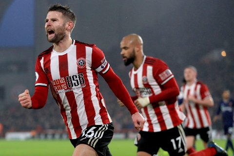 Sheffield United's Oliver Norwood celebrates scoring during the English Premier League soccer match between Sheffield United and Watford at Bramall Lane, Sheffield, England, Thursday Dec. 26, 2019. (Mike Egerton/PA via AP)