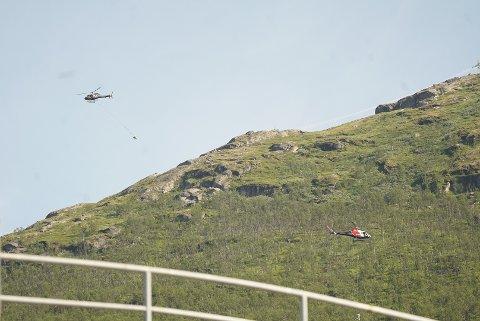 Helikoptre flyr i nesten utallige runder med betong opp til den nye stasjonen på fjellet.