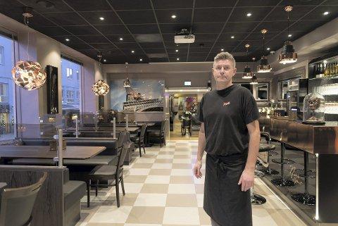 ROLIG START: Atle Mathisen og Pizzanini tar i bruk de nye lokalene.Foto: Jo E .Brenden