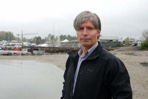 OLA ELVESTUEN, Klima- og miljøminister