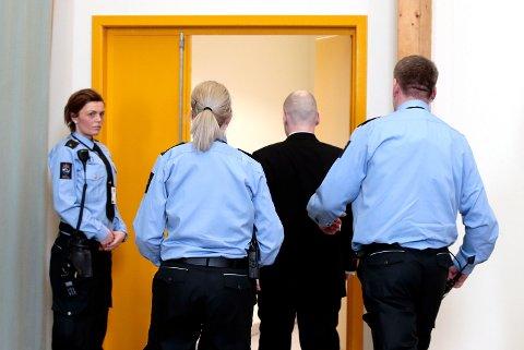 Anders Behring Breivik forlater rettslokalene i Skien fengsel. Foto: Lise Åserud / NTB scanpix
