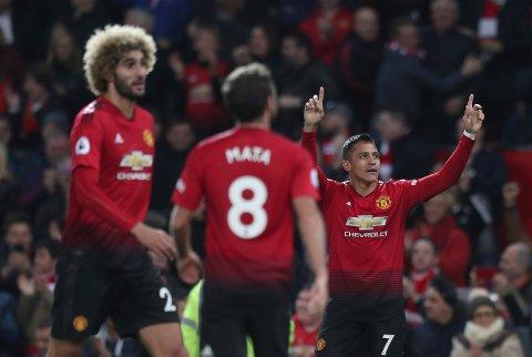 Alexis Sánchez (høyre) jubler etter å ha scoret vinnermålet mot Newcastle.